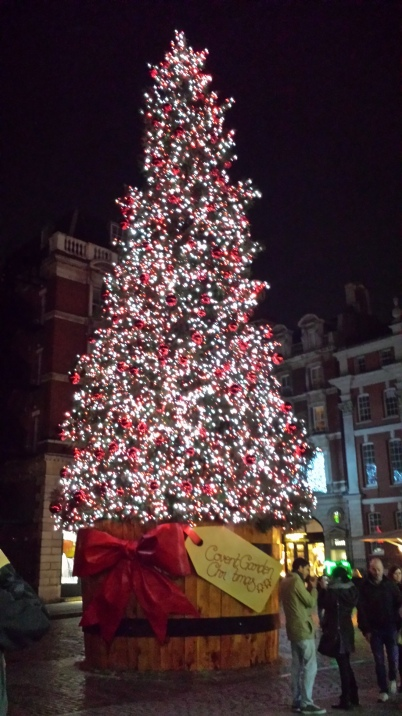 A giant Christmas tree in London's historic Covent Garden, The Christmas tree wears 50,000 red balls.